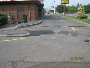 More asphalt patching. Add sealcoating to this prject and it will look brand new.